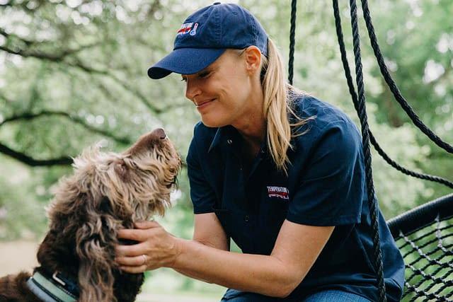 Friendly HVAC Technician and Scruffy Dog